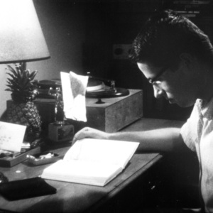 Student Seated at Desk Reading a Book in a Dormitory Room, St. John's College, Annapolis, Maryland