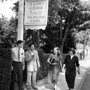 """Salvatore C. Di Grandi and Other Students Standing by the """"St. John's College Founded 1696 as King William's School"""" Sign on College Avenue, Annapolis, Maryland"""