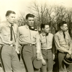 Stanley McComas, B. Franklin Barger, John M. Webb, Jr. and A. Morris Cunningham in Uniforms, Standing on Back Campus near College Creek, St. John's College, Annapolis, Maryland